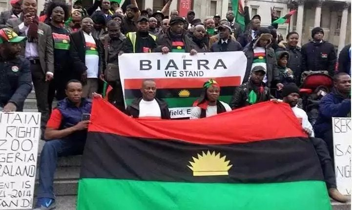 Members of IPOB hold Biafra flag and banner