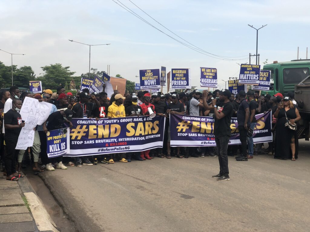 #EndSARS protesters carrying posters, banners and placards on which different messages showing their grievances were written.