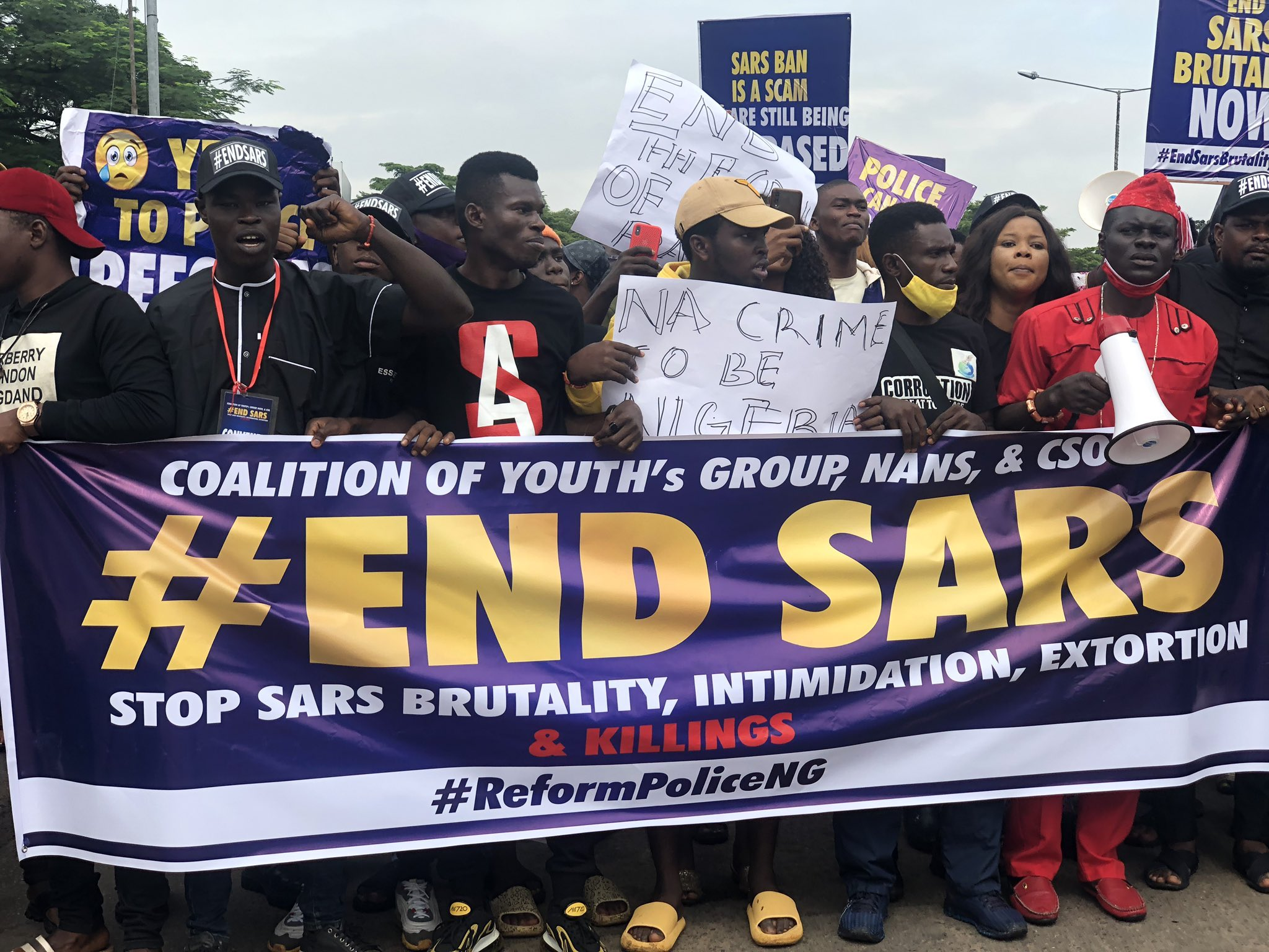 Protesters storm the streets to demand the dissolution of SARS, bearing placards and banners reading #EndSARS.