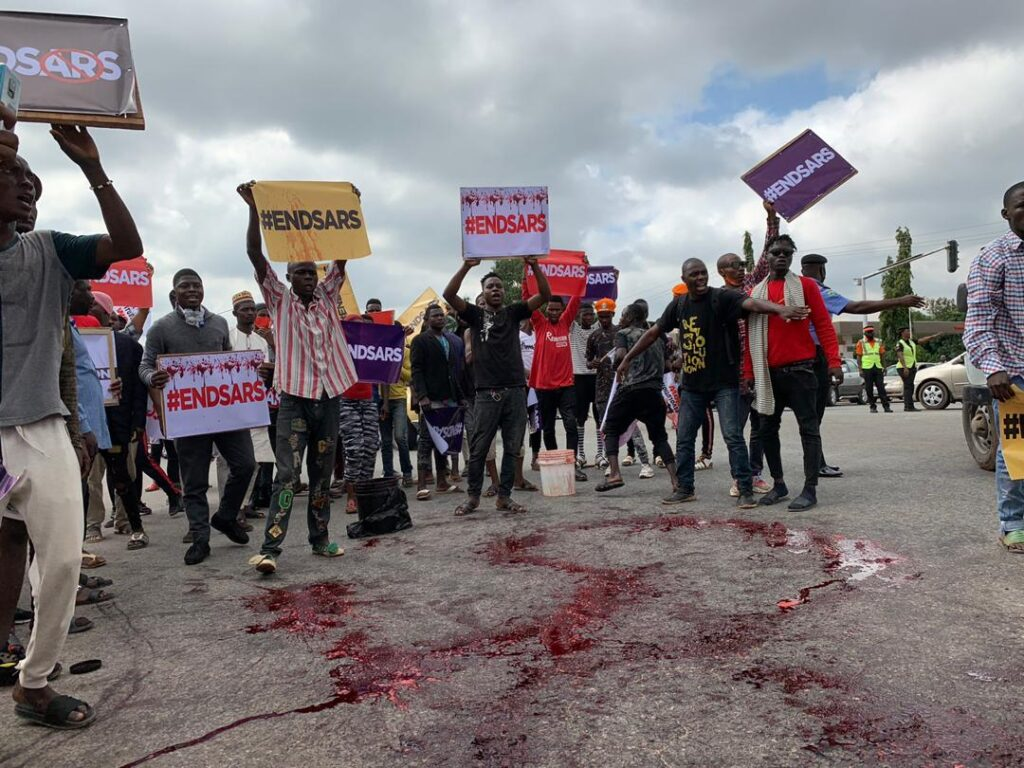 #EndSARS protesters in Abuja poured red paint on the road to signify the bloodshed and killings perpetrated by SARS operatives, many of whom have been indicted for rights violations, including extra-judicial killings, extortion, illegal detention and other misconduct.