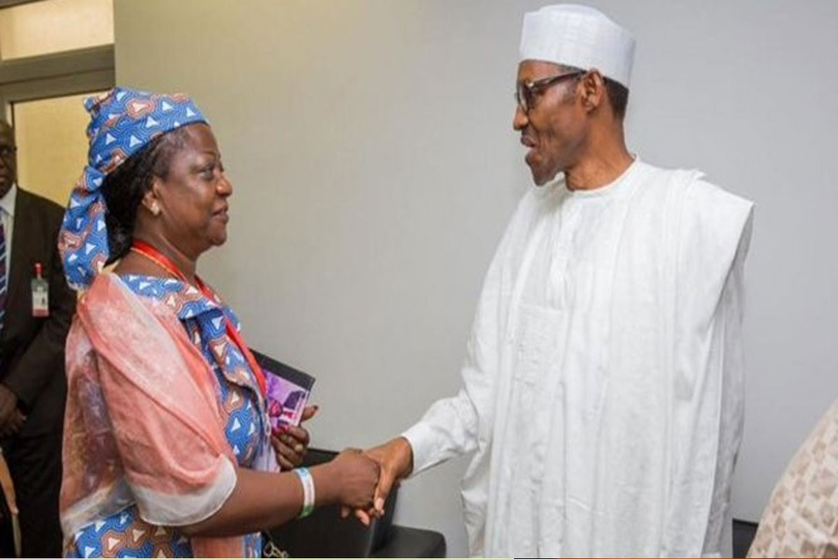 Lauretta Onochie and President Buhari having a handshake