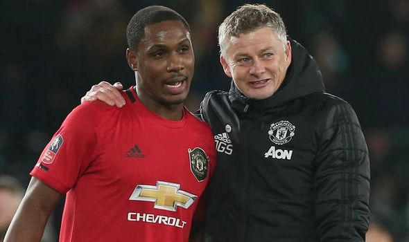 Ighalo and Solskjaer drape arms around each other's shoulders in a picture