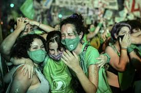 young women celebrating abortion bill in Argentina