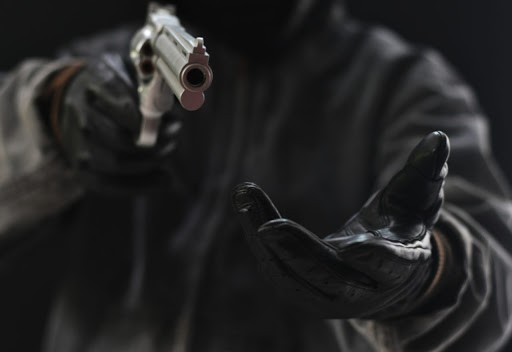 armed robber pointing a gun