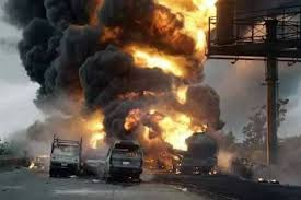 tanker filled with fuel burning on a road