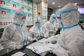 medical personnel trying to contain spread of viral disease