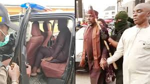 policemen carting away the former governor of Imo state