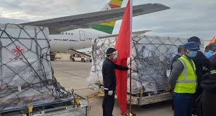 man offloading vaccines from an aeroplane