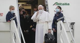 Pope Francis alighting from a plan